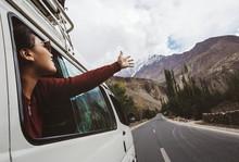 Young Woman Enjoying Traveling...