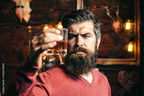 Alcoholic with bottle and glass drinking whiskey at night Fototapeta