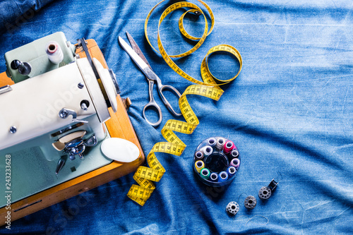 sewing indigo denim jeans with sewing machine, garment industrial concept Wallpaper Mural