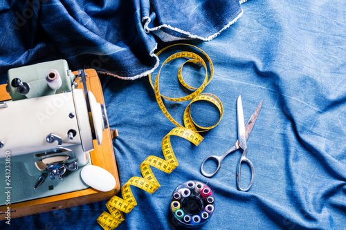 Photo sewing indigo denim jeans with sewing machine, garment industrial concept