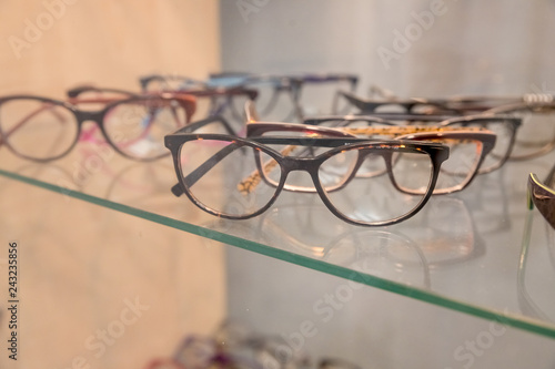 6670a9e42a0 Row of luxury eyeglass at an opticians store.eyeglasses at optician.Sideview  of fashionable optical eyeglasses