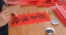 Old Man Pratice On Writing Chinese Calligraphy For Lunar New Year Words Means Happy New Year