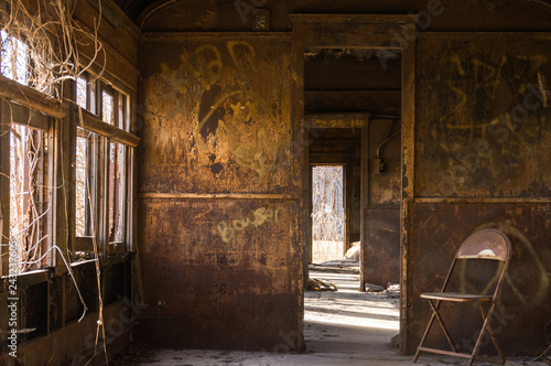 Interior of rusted vintage rail car with natural light coming through the windows Canvas Print