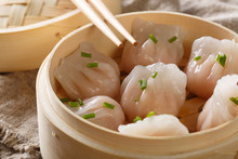 Chinese Prawn Dumplings Dim Sum Placed In A Bamboo Steamer On The Table. Horizontal