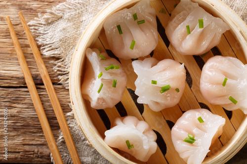 Chinese prawn dumplings dim sum placed in a bamboo steamer. horizontal top view