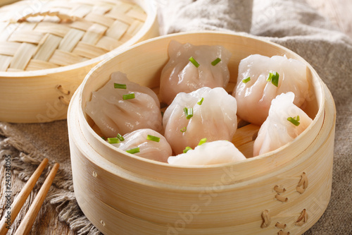 Dim Sum in bamboo steamer, Chinese cuisine. Closeup rustic. horizontal