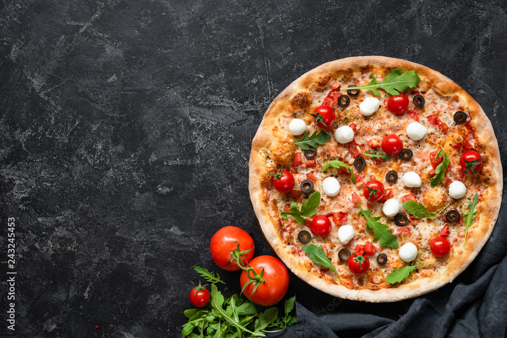 Tasty pizza with tomatoes and mozzarella on black background. Top view, copy space for text. Hot Italian pizza