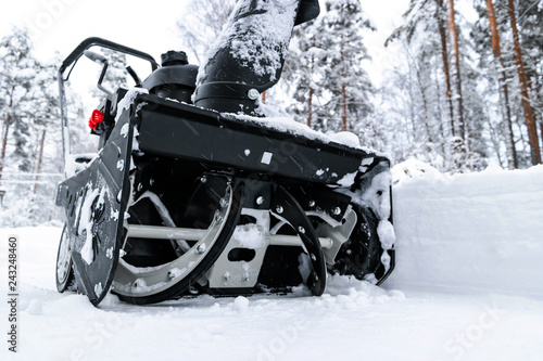 Snowblower at work on a winter day Canvas Print