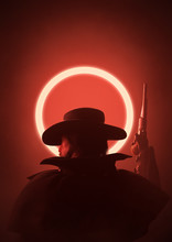 Silhouette Of Cowboy With A Raised Weapon In His Hand. Red Background With Glowing Circle. Abstract Illustration Of A Sunset In The Wild West. Creative Cover Design For The Western World. 3D Rendering