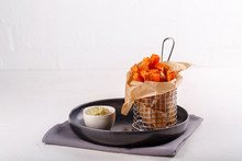 Sweet Potato Fries Baked With Herbs And Served With Avocado Sauce.