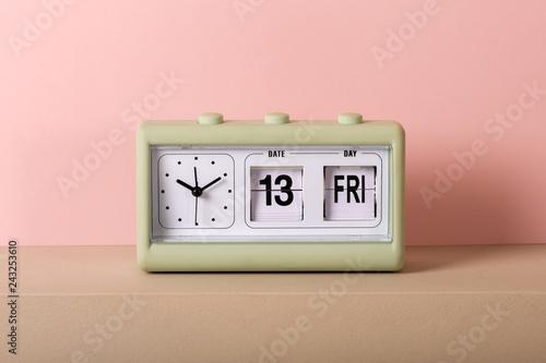 Fototapeta Vintage clock with calendar showing Friday 13th