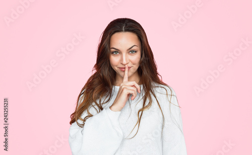 Fotografie, Obraz  Pretty girl covering mouth with finger
