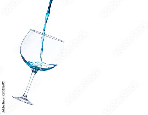 Fotografie, Obraz  liquid splashing into a cocktail glass on a white background