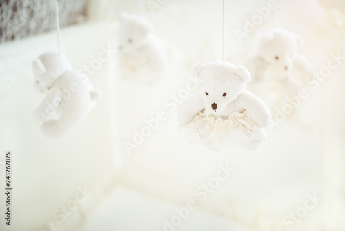 White baby cot for newborn with hanging bears Wallpaper Mural