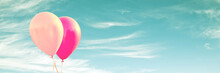 Two Pink Balloons On Panoramic Sky Background, Love And Couple Concept