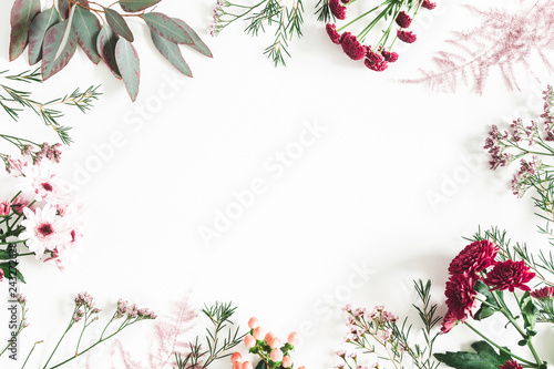 Flowers composition. Eucalyptus leaves and pink flowers on white background. Flat lay, top view