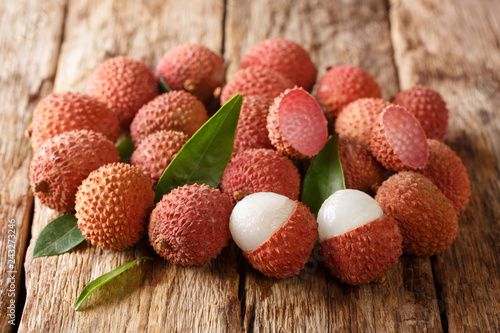 Fresh organic lychee fruit on a wooden background. horizontal