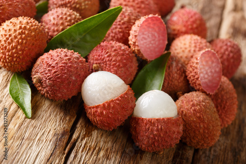 fresh organic lychee fruit on wood background. horizontal
