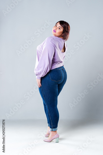 Obraz Plus size fashion model in casual clothes, fat woman on gray background - fototapety do salonu