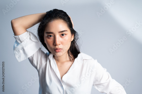 Poster womenART Portrait young Asian girl on white background.