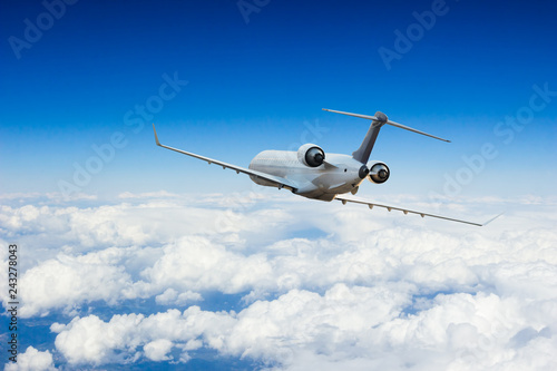 Staande foto Helicopter Passengers commercial airplane flying above clouds