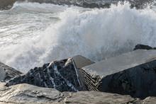 Sea Waves Breaking In The Rocks