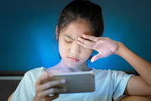 Teenage Girl  Hurt Her Eyes Because She Played The Smart Phone In The Dark Light  And The Blue Light Has A Negative Effect On The Child's Eyes.