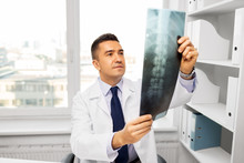 Medicine, Healthcare And People Concept - Doctor With X-ray Scan At Hospital