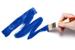 Hand painting using a thick blue brush, isolated on white background