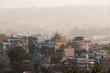 Pagoda and surrounding buildings in the foggy Kathmandu, Nepal.