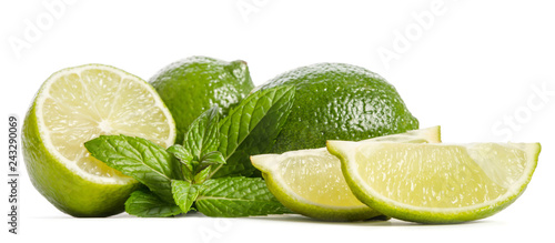 green mint, two limes and  two slices of a juicy lime isolated on white background