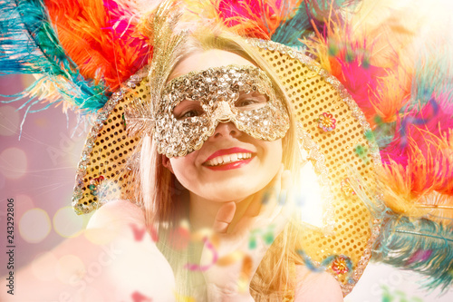 Beautiful young woman in carnival mask Canvas Print