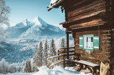 Fototapeta Nature - Traditional mountain cabin in the Alps in winter