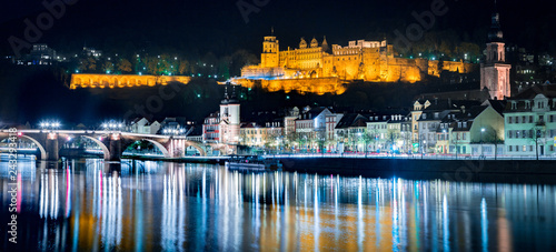 Poster Centraal Europa Heidelberg city panorama with Neckar river at night, Baden-Wurttemberg, Germany