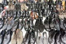 Old And Vintage Shoes And Boots In A Flea Market