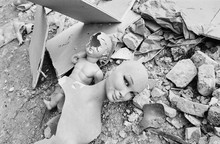 1980 Vintage Analog Photography Of Old Discarded And Destroyed Woman And Child Mannequins In Midst Of Torn Down Fashion Shop Debris In Italy.