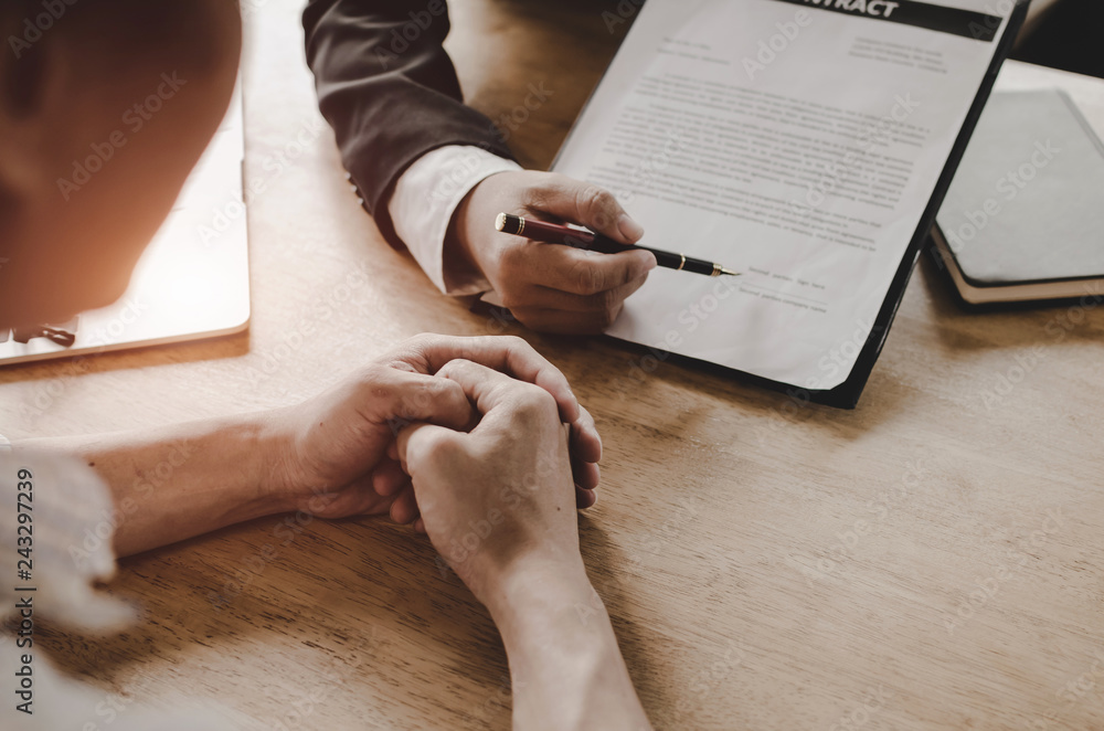 Fototapeta legal consultants, notary or justice lawyer discussing contract document on desk with client customer in courtroom office, business, justice law, insurance, legal service, buy and sell house concept