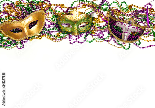 Festive Carnival background with masks, beads and copy space.