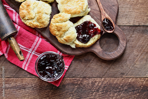 Buttermilk southern biscuits or scones served with homemade fruit preserves Fototapeta
