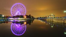 A Large Ferris Wheel In Montre...