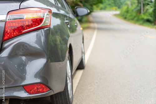Fotografie, Obraz  Back of gray car get damaged from accident on the road