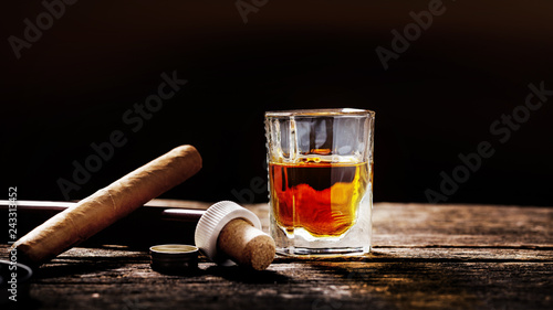 Whisky and cigar on the timber table