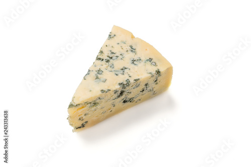 Wedge of soft blue cheese with mold isolated on white background.