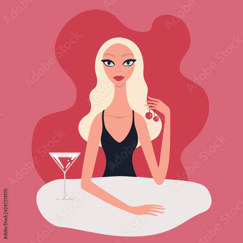 Hot beautiful young blond woman with perfect make-up red lipstick blue eyes wearing black evening dress sitting at table drinking cocktail with cherries Aperitives Alcoholic drinks Restaurant Cafe Fototapet