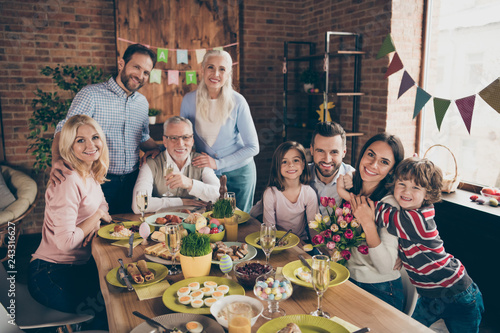 Close up photo of large company gathered family holiday sitting