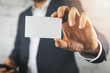 Leinwandbild Motiv businessman hand showing blank white business card closeup