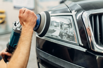 Detailing of car headlights with polishing machine