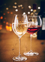 Glasses Of Red And White Wine With Party Bokeh