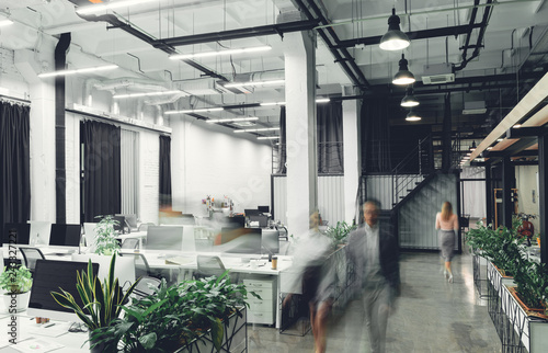 Obraz modern office interior with blurred business people in motion - fototapety do salonu