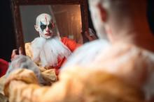 Portrait Of Clown Reflected In Mirror